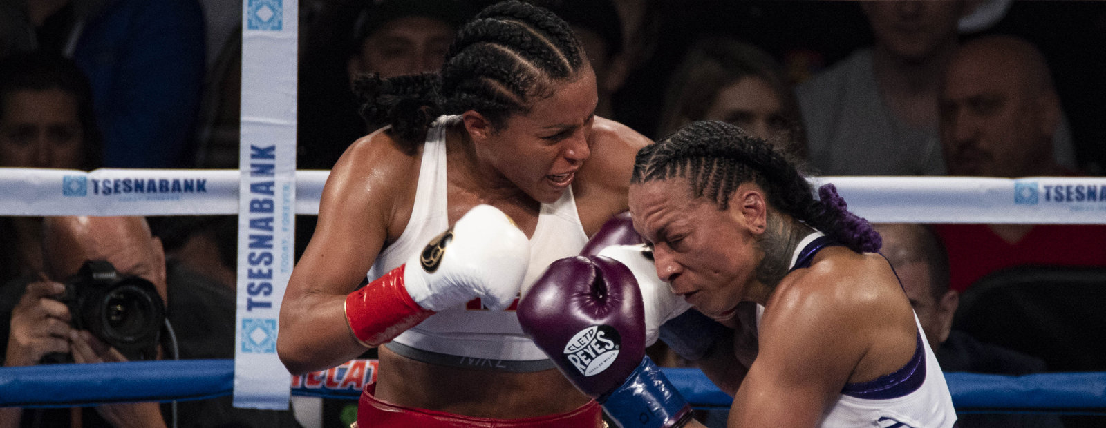 Two women boxing.